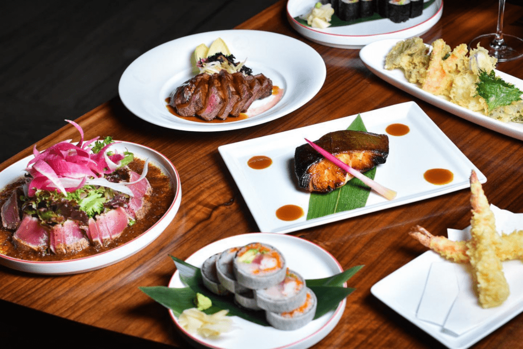 A selection of dishes served at Nobu, including black cod with miso, prawn tempura and sushi