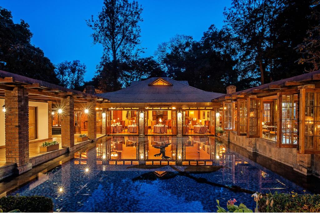 Tanzania - Elewana Arusha Coffee Lodge pool at night
