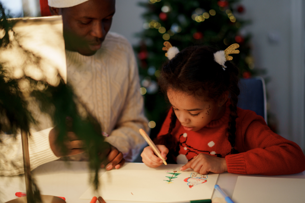 A father and daughter making decorations this festive season