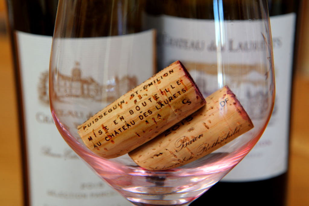 St Emilion corks in an empty glass