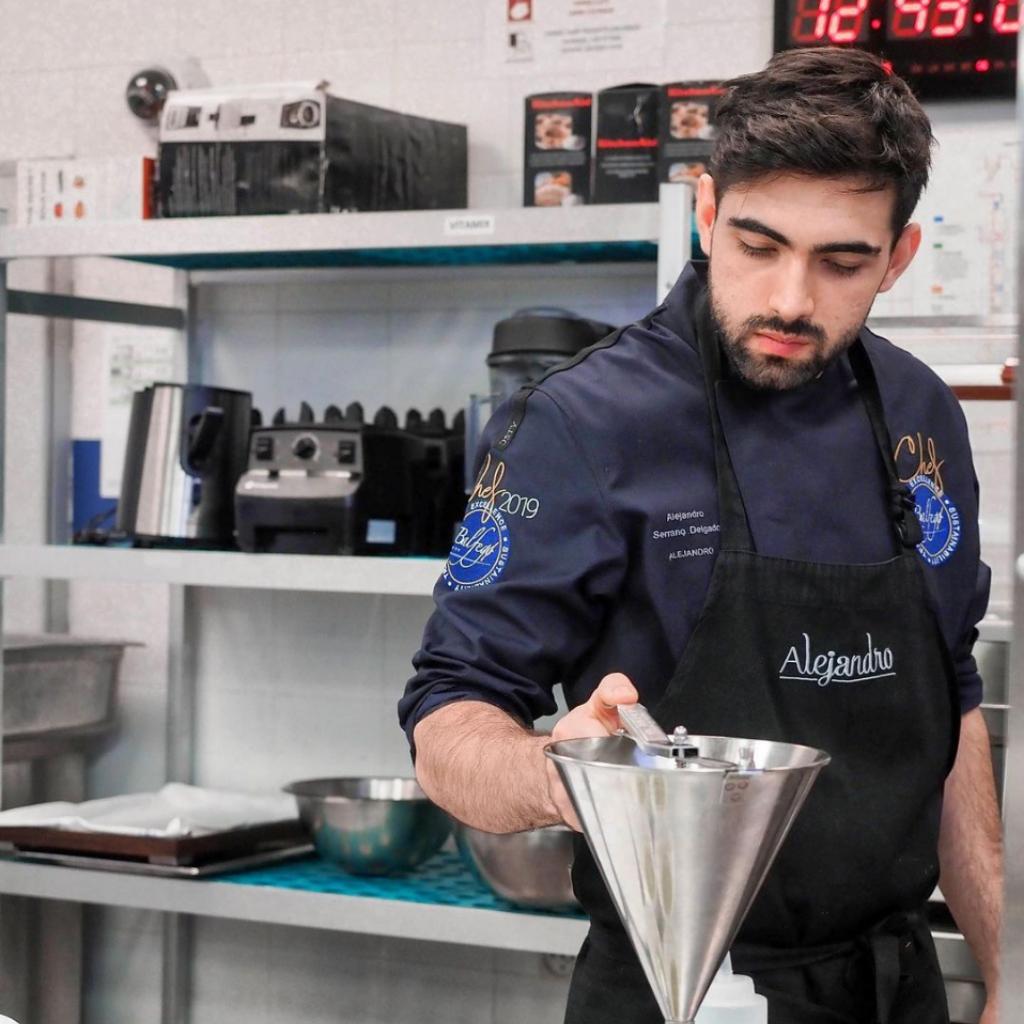 Alejandro Serrano cooking in a kitchen