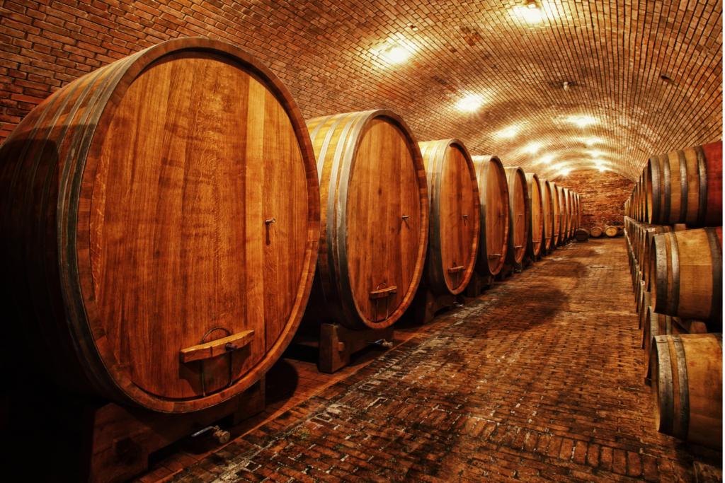 An underground cellar with wine bottles