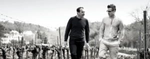 Brad Pitt and Marc Perrin walking through the vineyard of at Château de Beaucastel